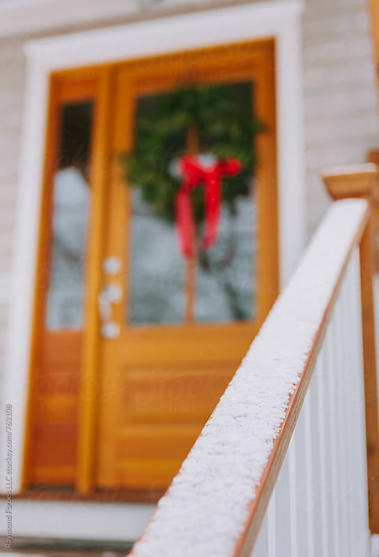 Front Door of Home with Holiday Wreath by Raymond Forbes LLC for Stocksy United