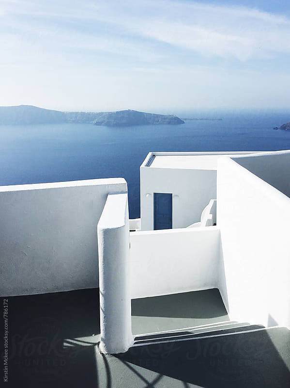 White and blue building, Santorini by Kirstin Mckee for Stocksy United