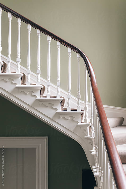 Curved staircase by Jen Grantham for Stocksy United