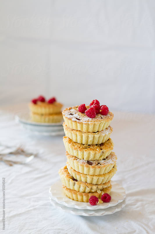 Rhubarb and frangipane tartlets with raspberry by Noemi Hauser for Stocksy United