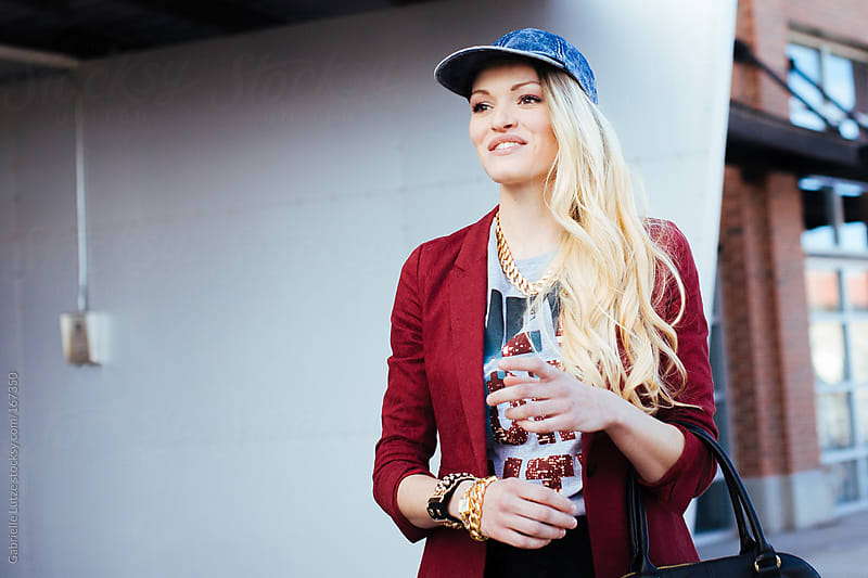 Fashionable Blond Woman in the City by Gabrielle Lutze for Stocksy United