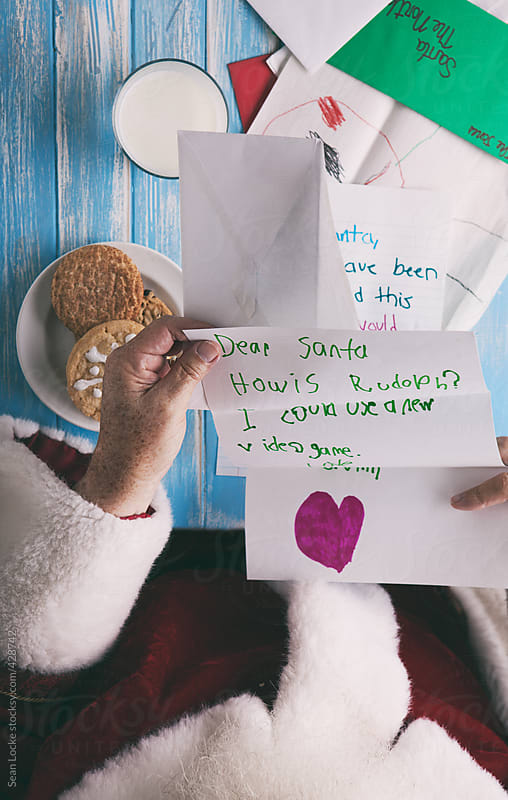 Santa Claus Reads Letters From Children by Sean Locke for Stocksy United