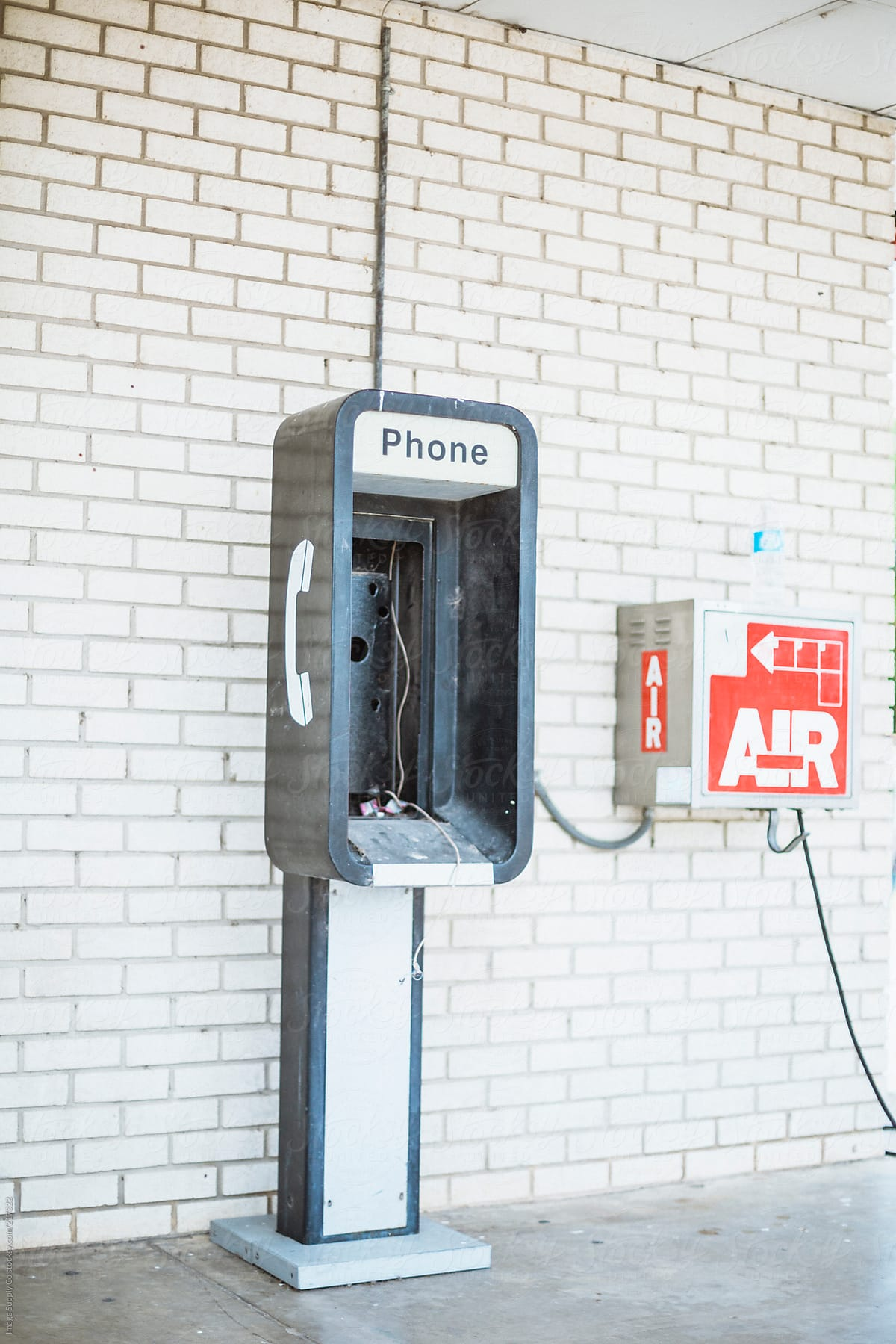 Stock Photo - Broken Pay Phone Outside