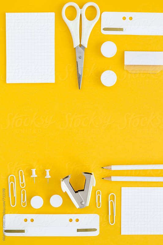 White office utensils on yellow background by Melanie Kintz for Stocksy United