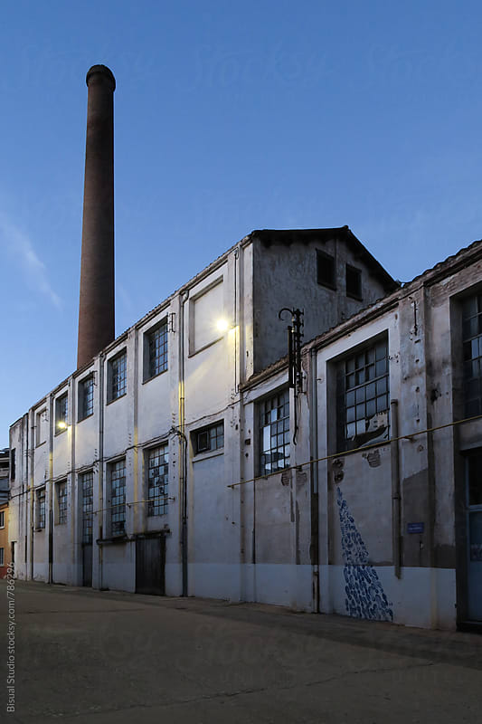 Old ruin factory at blue hour by Bisual Studio for Stocksy United
