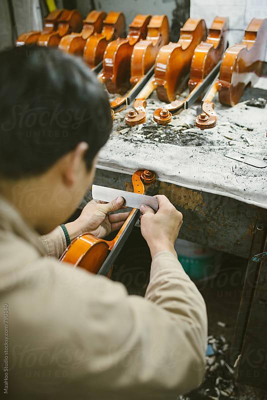 Violin maker at work by MaaHoo Studio for Stocksy United