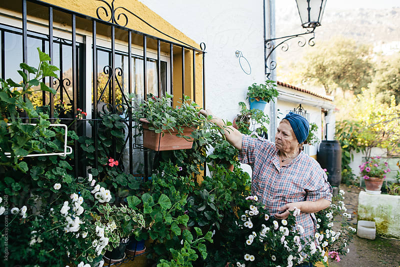 Senior woman maintaining her garden  by kkgas for Stocksy United