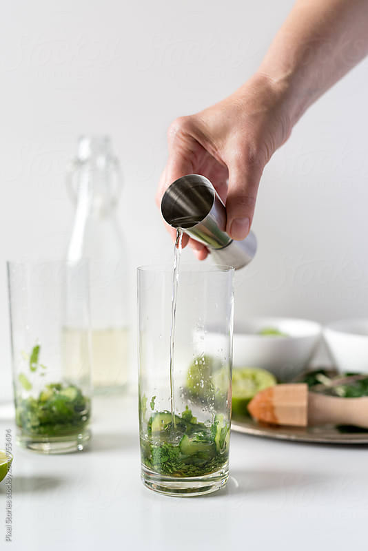 Making cucumber-mint mojito by Pixel Stories for Stocksy United
