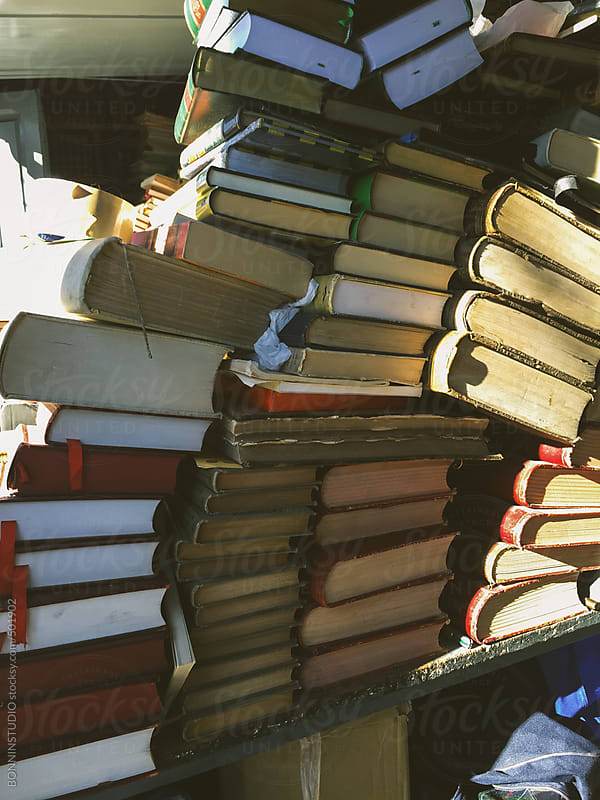 Stack of old books for sale on the street at book market. by BONNINSTUDIO for Stocksy United
