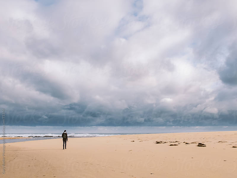 Lone Fisherman on a Beach under a Big Sky by Gary Radler Photography for Stocksy United
