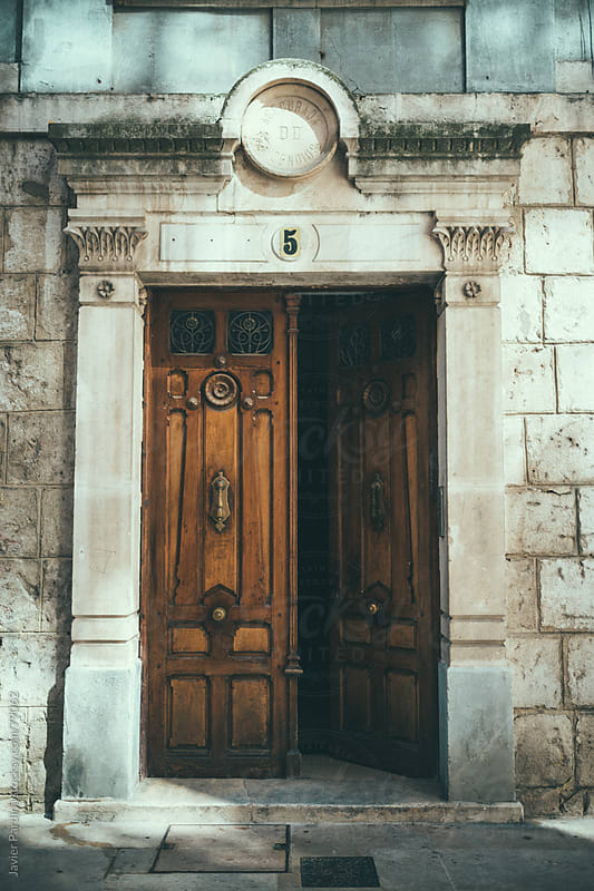Classic open door at street by Javier Pardina for Stocksy United