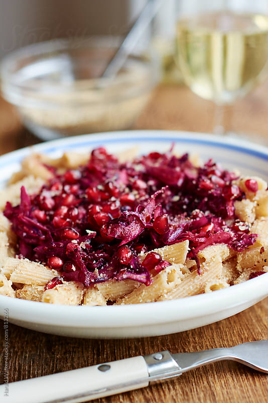 Wholewheat pasta with Red Cabbage and Pomegranate Arils by Harald Walker for Stocksy United