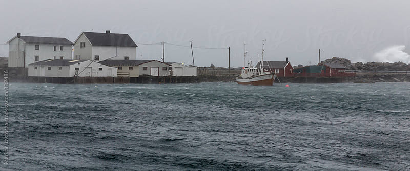 Fishing boat in harbor with rainy and stormy weather by Marilar Irastorza for Stocksy United