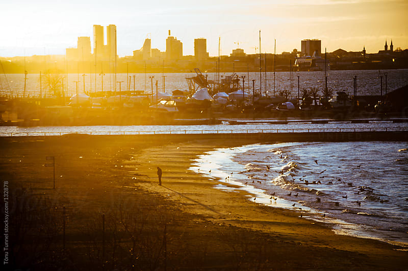 A lone man on the beach by Tõnu Tunnel for Stocksy United