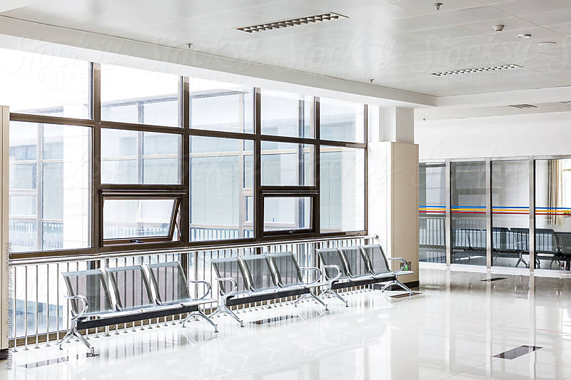 Empty chairs in waiting area at hospital by MaaHoo Studio for Stocksy United