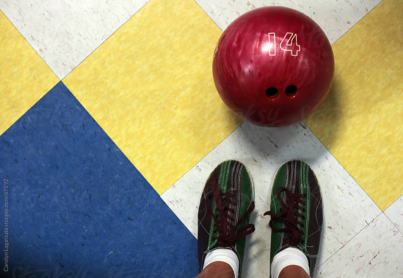 At the bowling alley by Carolyn Lagattuta for Stocksy United