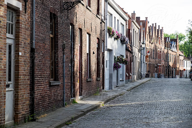 Street with houses in Bruges, Belgium by Jeff Wasserman for Stocksy United