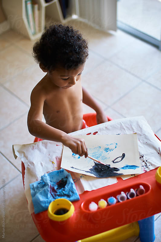 Mixed Race Toddler Painting  by Marlon Richardson for Stocksy United