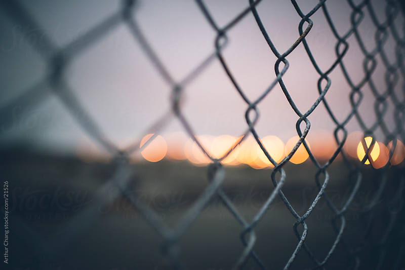 Fence Bokeh by Arthur Chang for Stocksy United