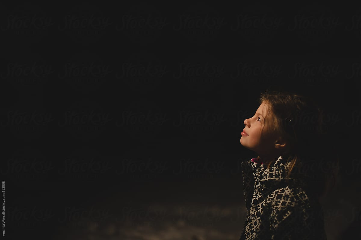 Profile Of Young Girl Looking Up At Night Sky In Winter By Amanda Worrall Stocksy United