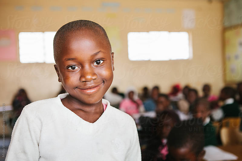 Cute African Namibian school girl in a classroom by Micky Wiswedel for Stocksy United