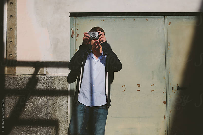 Young Man Take Picture With Camera by HEX. for Stocksy United