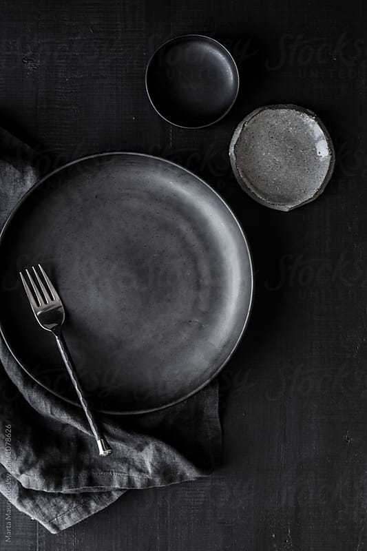 Black and grey plates by KEMA Food Culture for Stocksy United