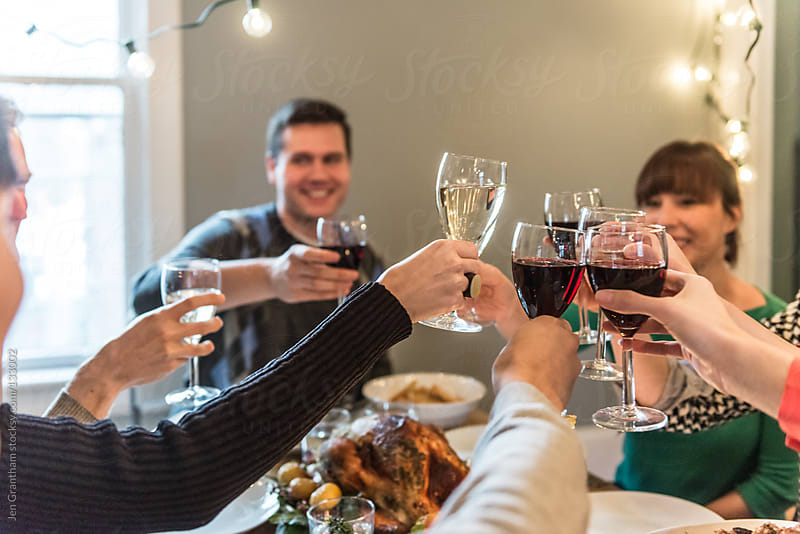 Christmas Dinner: Cheers by Jen Grantham for Stocksy United