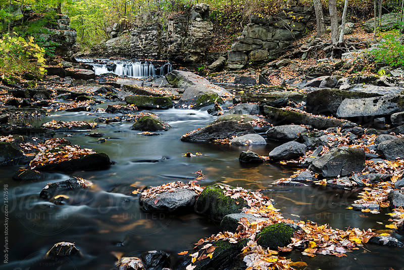 Autumn Waterfall by Rob Sylvan for Stocksy United