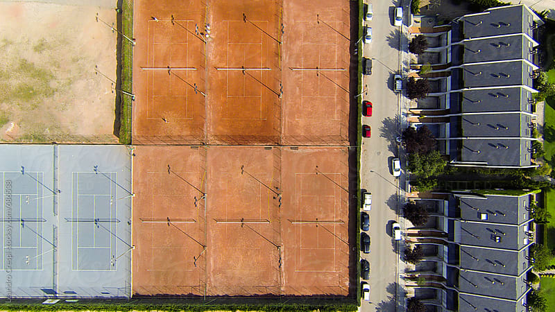 A tennis court seen from a flying drone by Leandro Crespi for Stocksy United