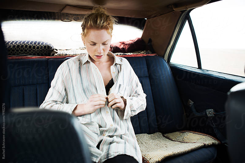 Girl in car by Rachel Schraven for Stocksy United
