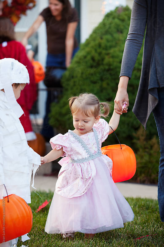 Halloween: Princess Out With Family On Halloween by Sean Locke for Stocksy United