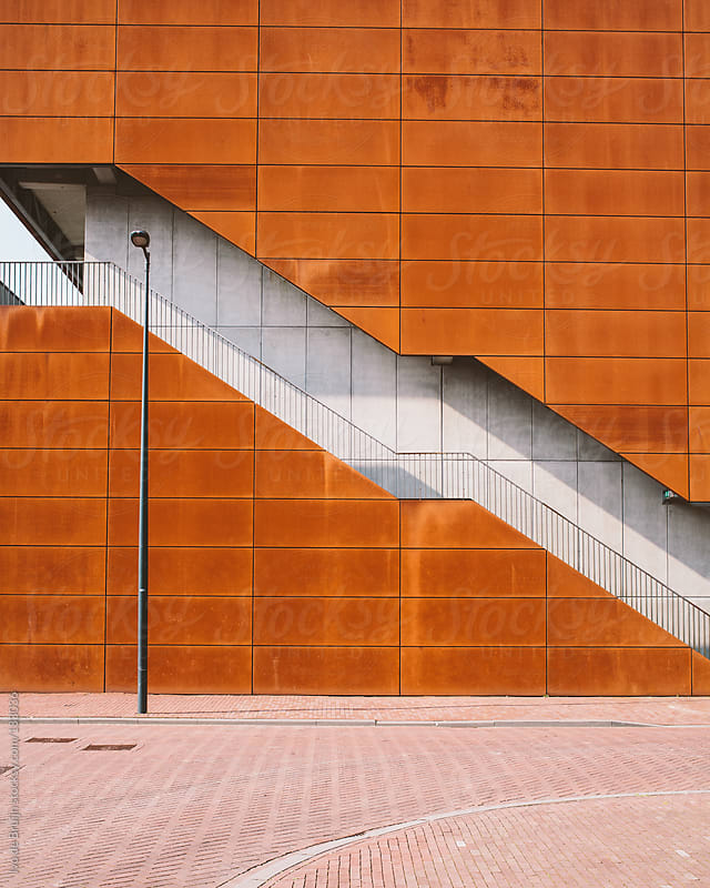 Modern building with rusty plates and stairs by Ivo de Bruijn for Stocksy United