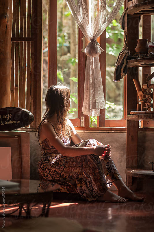Woman Sitting by the Window in the Morning Sun by Mosuno for Stocksy United