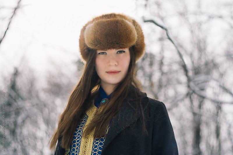 Portrait of a beautiful girl wearing winter hat by Aleksandra Jankovic for Stocksy United