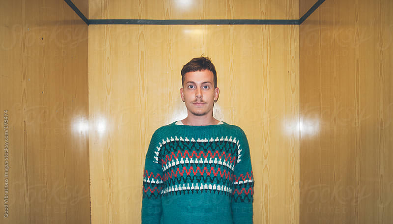 Young Man with Green Sweater by Good Vibrations Images for Stocksy United