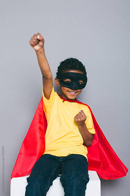 Portrait of a smiling little boy with Superhero costume. by BONNINSTUDIO for Stocksy United