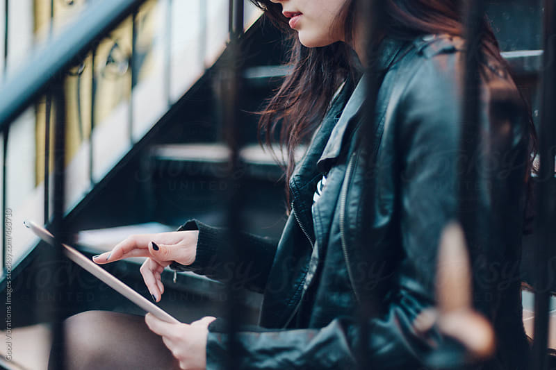 Woman using a digital tablet by Good Vibrations Images for Stocksy United