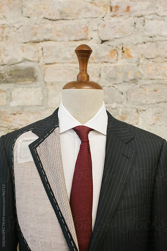 Men's Fashion - Close Up of Expensive Blue Pinstripe Suit on Hanger Stand by Julien L. Balmer for Stocksy United