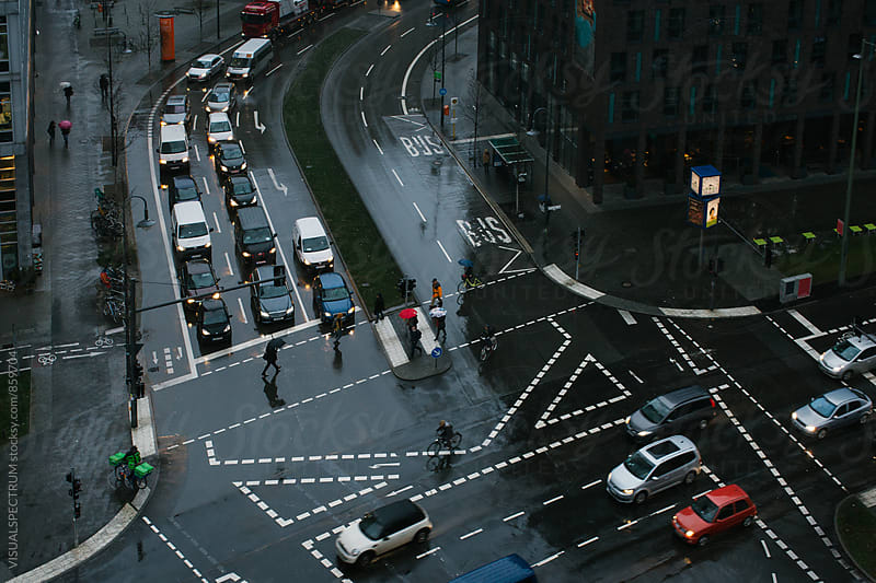 Traffic and Crossroad on Rainy Day Overhead by Julien L. Balmer for Stocksy United