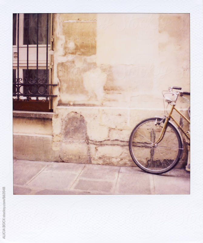 Polaroid Of A Vintage Bike On A Quiet Street In Paris France by ALICIA BOCK for Stocksy United
