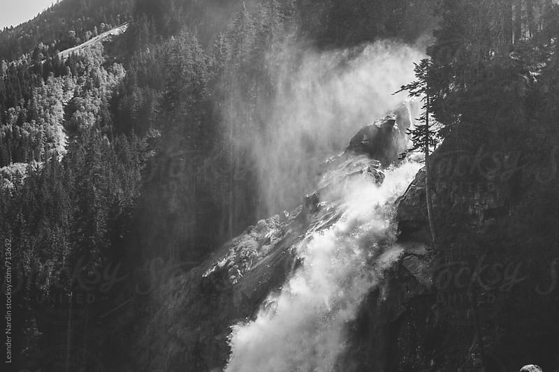 powerful waterfall in black and white by Leander Nardin for Stocksy United