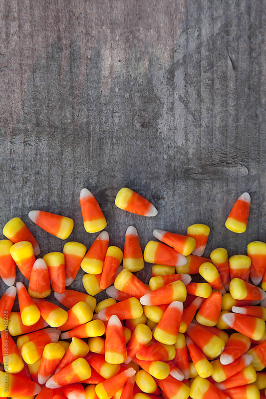 Candy Corn on Wood Background by Brandon Alms for Stocksy United
