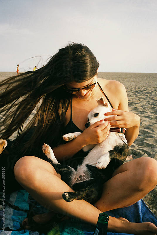 A girl and a dog by Aleksandra Martinovic for Stocksy United