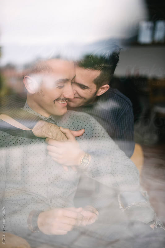 Affectionate male gay couple together by GIC for Stocksy United