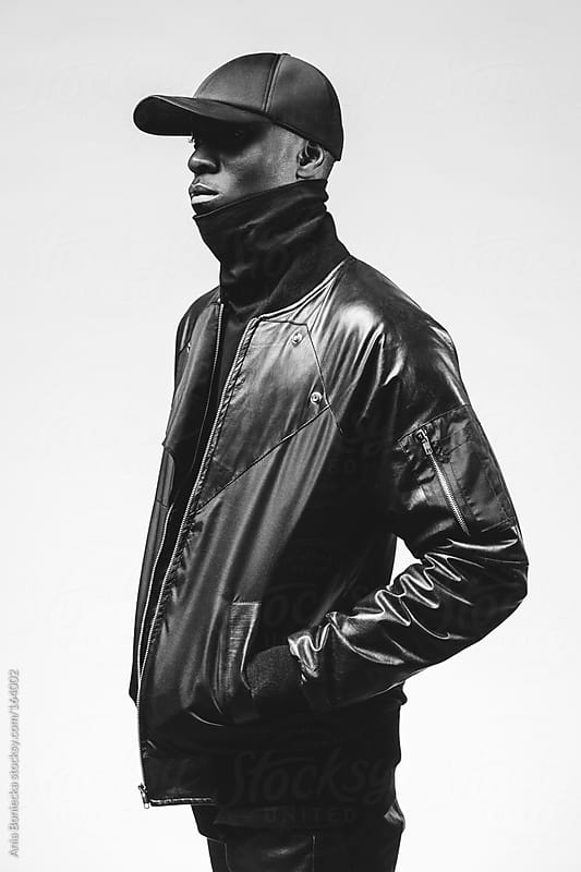 Black & white studio portraits of a fashionable young black man by Ania Boniecka for Stocksy United