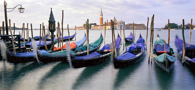 Gondolas moored with the island of San Giorgio Maggiore beyond, Venice, Veneto, Italy, Europe  by Gavin Hellier for Stocksy United