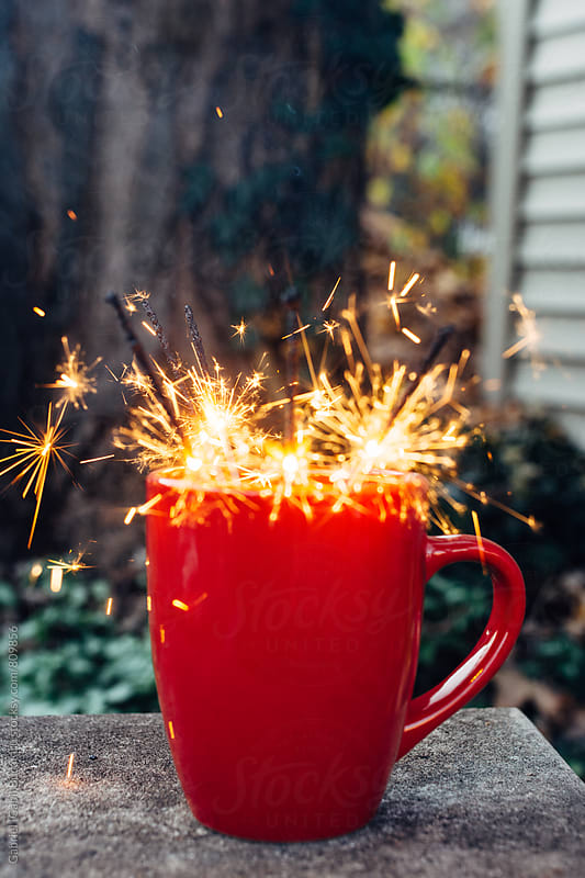 Red cup with sparklers by Gabriel (Gabi) Bucataru for Stocksy United