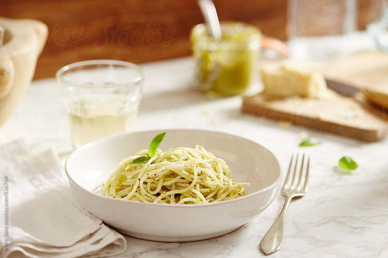 Rice spaghetti with pesto sauce by Martí Sans for Stocksy United