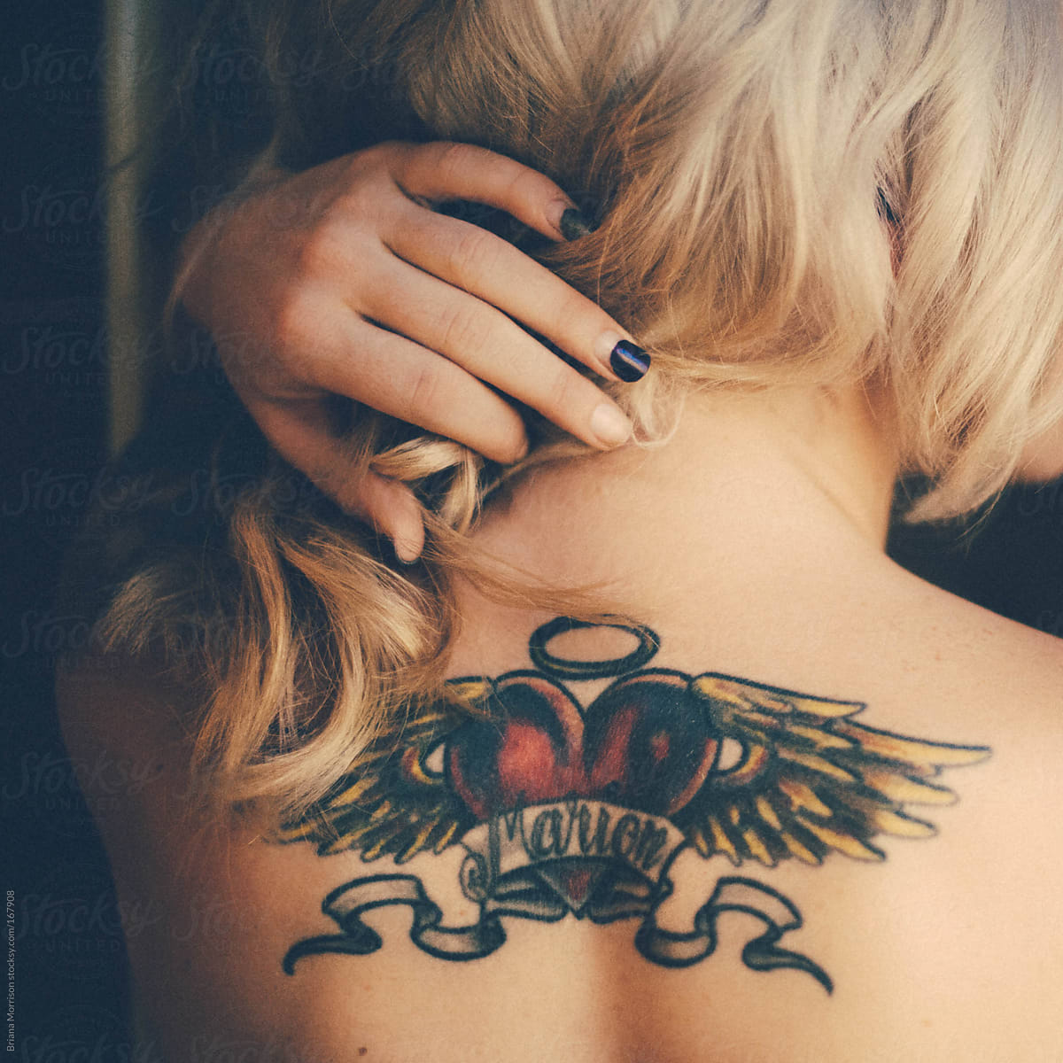 Blond Woman With Heart And Angel Wing Tattoo On Her Back Stocksy